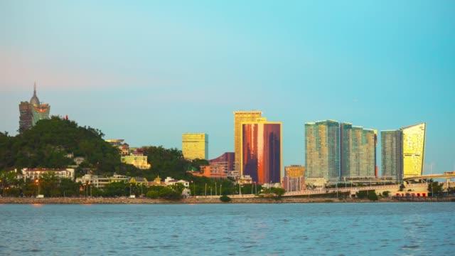china sunset zhuhai bay macau city famous hotels coastline panorama 4k timelapse - zhuhai video stock e b–roll
