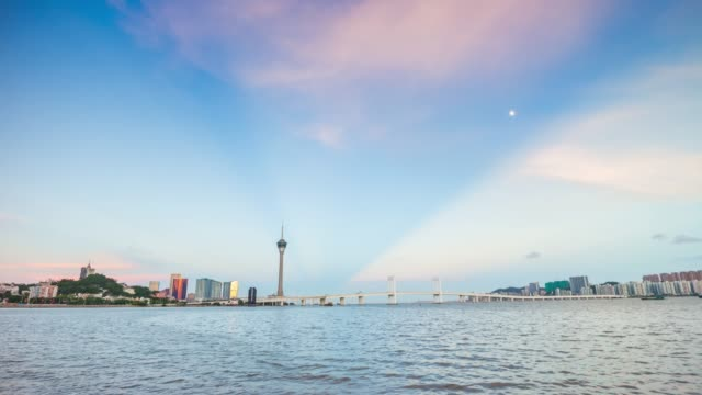 china sunset zhuhai bay macau city famous tower coastline panorama 4k timelapse - zhuhai video stock e b–roll