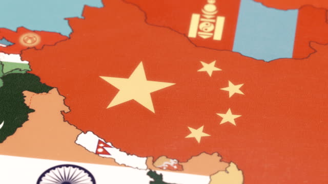 China with National Flag on World Map China with National Flag on World Map china east asia stock videos & royalty-free footage