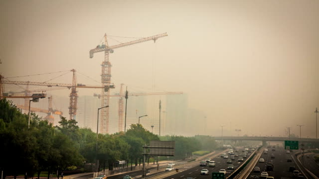 China's capital city of Beijing street traffic of automobiles. Foggy day, smog, air pollution. video