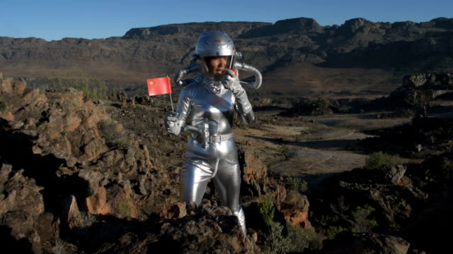 Chinese Astronaut plants a flag on another planet