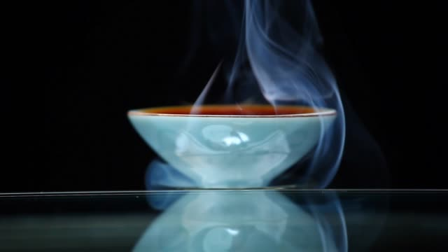 chinese black tea cup smoke dark background nobody hd footage - porcellana video stock e b–roll