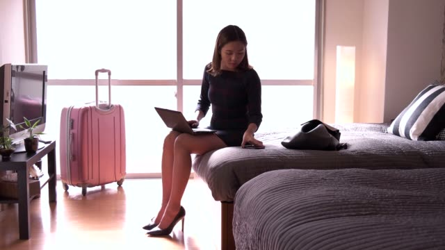 Chinese Businesswoman Woman Working With Computer Hotel Room Business Travel video