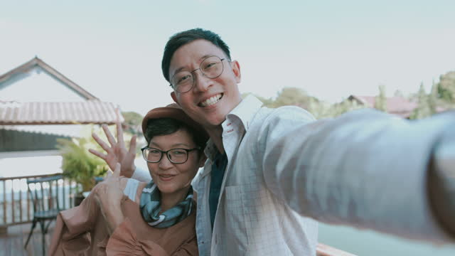 Chinese family taking selfie-stock video video