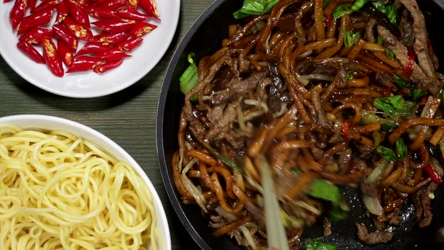 Chinese Fried Beef And Udon Noodles Chinese Wok Fried Beef And Udon Noodles stir fried stock videos & royalty-free footage