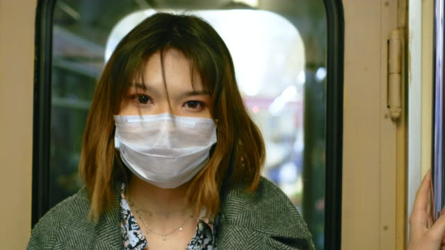 Chinese Girl Look Camera. Respiratory Mask Face. People China Public Transport. video