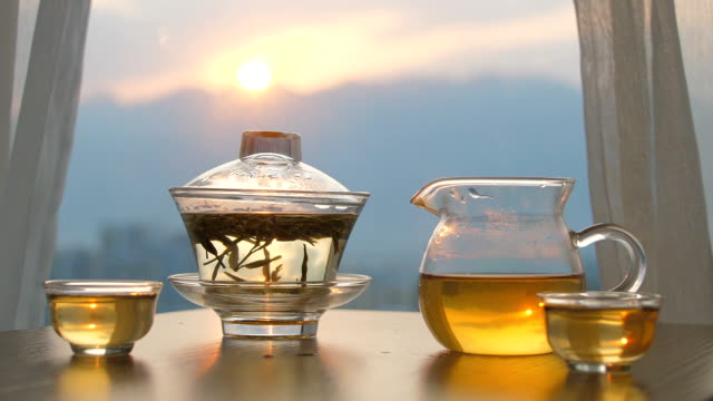 Chinese herbal tea cup on table by window