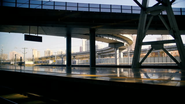 Chinese high speed train leaves station. View from the inside Chinese high speed train leaves station. Beijing railway station. subway platform stock videos & royalty-free footage