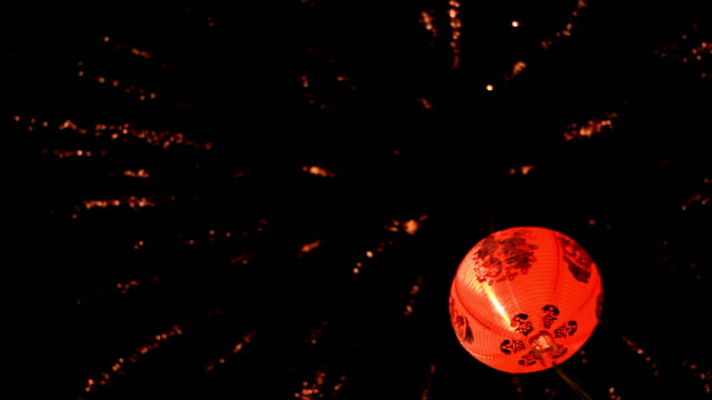 Chinese Lantern A chinese lantern and fireworks is background. chinese new year stock videos & royalty-free footage