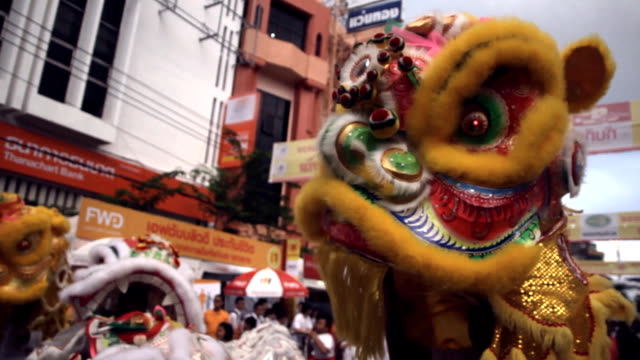 Chinese lion dancing parade Chinese lion dancing parade, HD 1920 x 1080 format. chinese new year stock videos & royalty-free footage