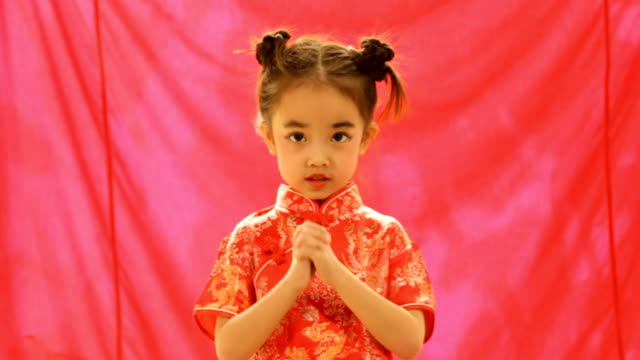 Chinese little girls in wishing gesture video