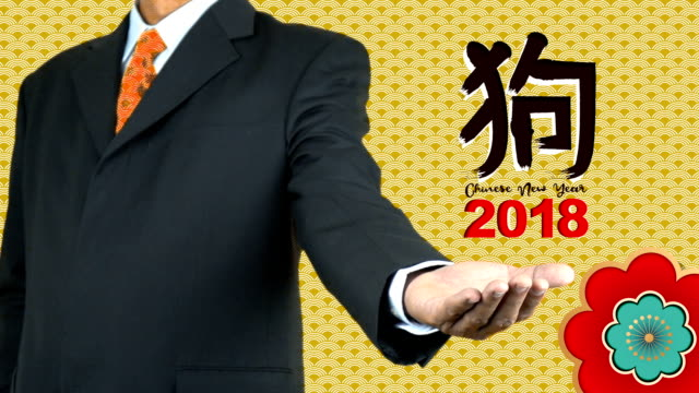 chinese new year 2018 theme man showing chinese letter on gold background stock video more clips of adult 913608556 istock