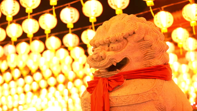 Chinese New Year , Guardian Lion Statue in Chinese temple video