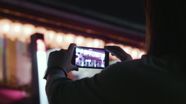 Chinese new year woman uses a smartphone to video view video