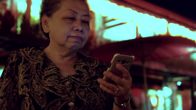 Chinese new year woman uses a smartphone