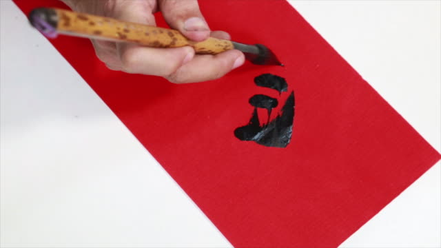 Chinese people writing Chinese Calligraphy video