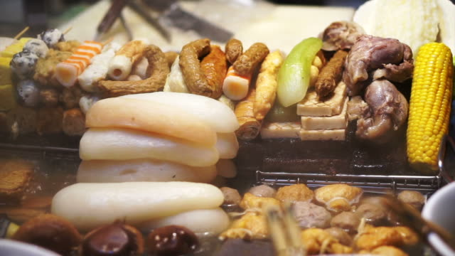 Chinese, Taiwanese open style, meatballs and food on stick with hot soup video