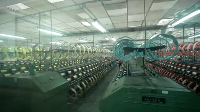 Chinese textile factory interior and machines working scene Chinese textile factory interior and machines working scene fabric swatch stock videos & royalty-free footage
