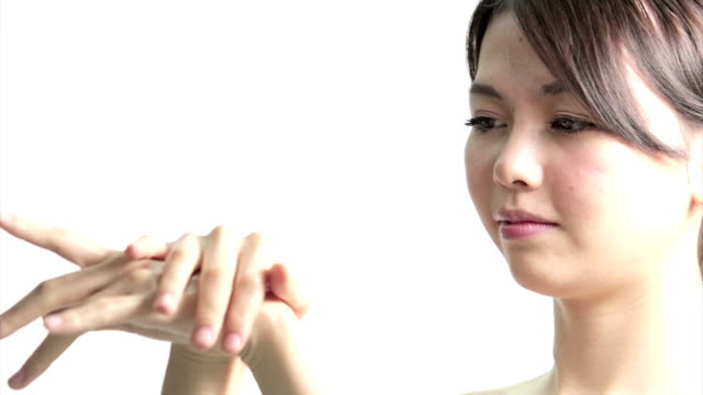 Chinese Woman Applying Cream to Hands video