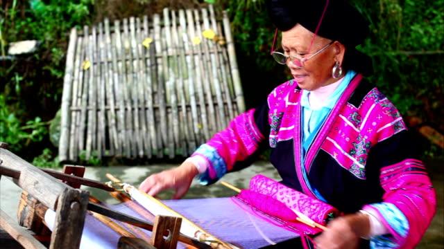 Chinese women weaving in longsheng video