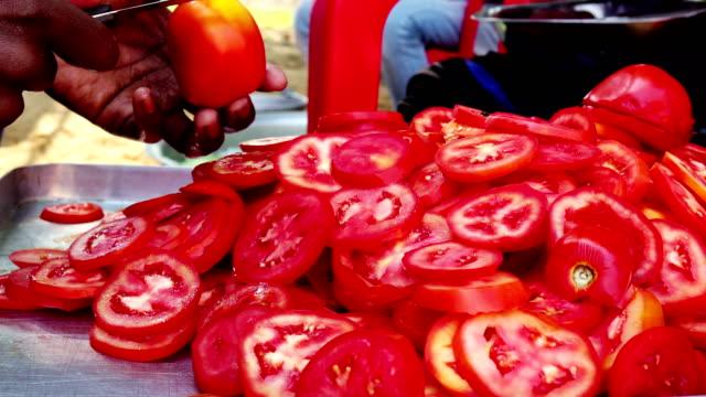 chipping fresh salad Human hand chipping fresh tomato salad. tomato salad stock videos & royalty-free footage