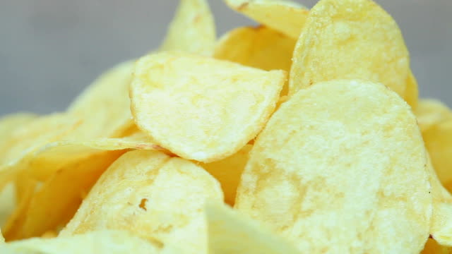 Chips Potato chips rotating potato chip stock videos & royalty-free footage