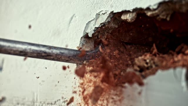 SLO MO LD Chisel drilling into the wall to break it down video