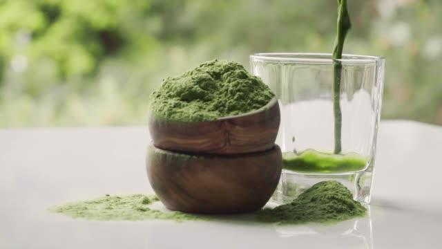 chlorella and barleygrass. - healthy green juice video stock e b–roll