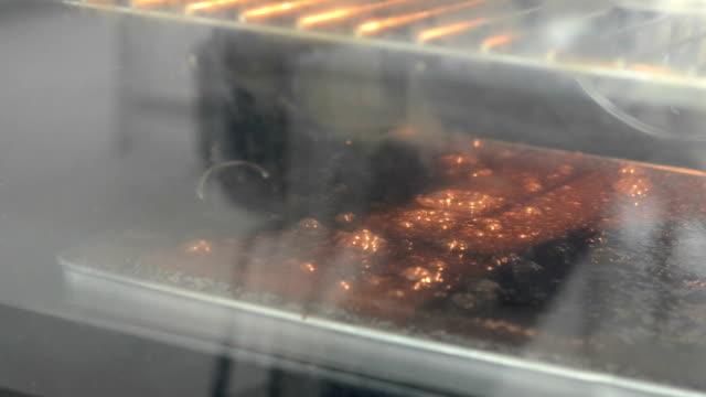 chocolate bread in oven - brownie bildbanksvideor och videomaterial från bakom kulisserna