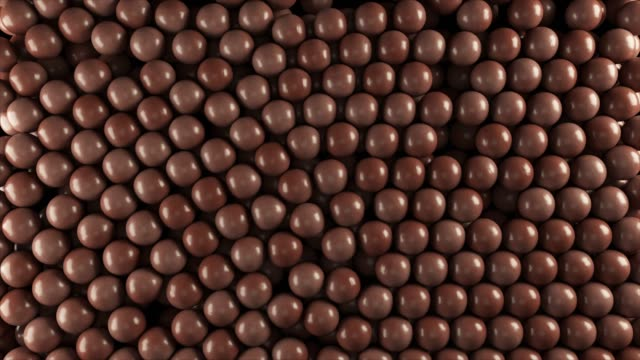Chocolate candy balls with alpha matte Cg animation of the chocolate candy balls with alpha matte alpha channel stock videos & royalty-free footage
