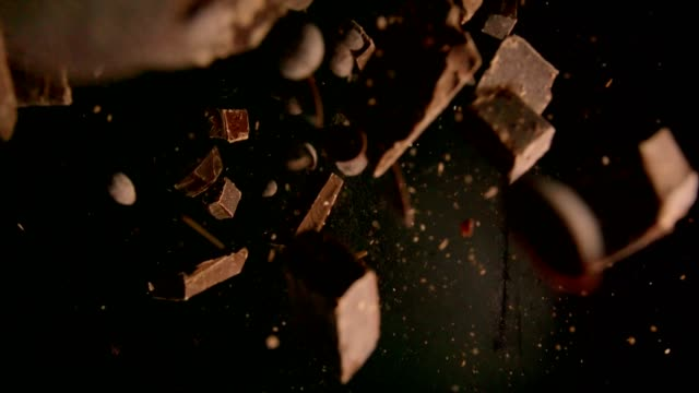 chocolate food explosion with chocolate chips - cioccolato video stock e b–roll