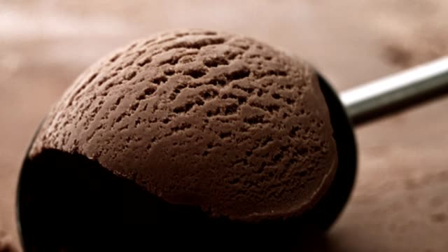 chocolate ice cream scooping - cioccolato video stock e b–roll