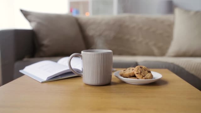 vídeos de stock e filmes b-roll de chocolate oatmeal cookies and mug with hot drink - hygge