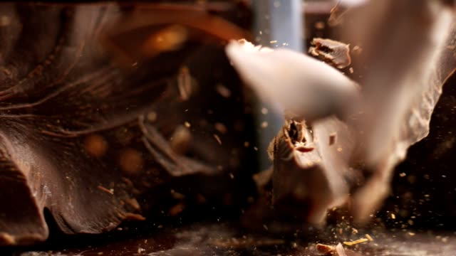 chocolate pieces falling down - cioccolato video stock e b–roll