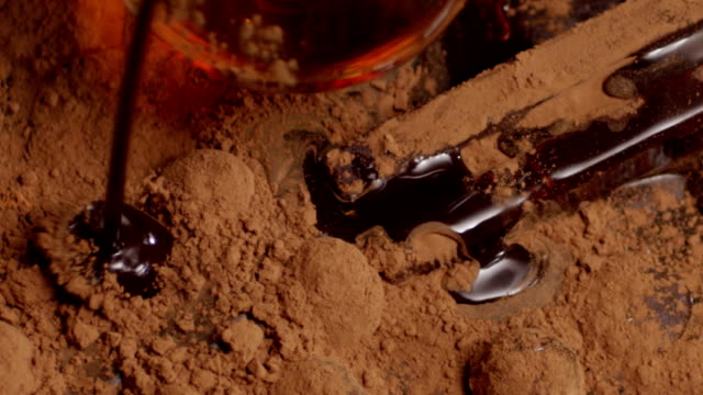 Chocolate pouring, dripping Into cacao slow motion. Shot on RED EPIC Cinema Camera. video