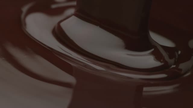 Chocolate pouring in slow motion (closeup)