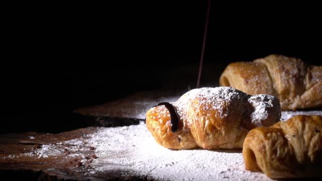 stockvideo's en b-roll-footage met chocolade kruiden op croissant brood en ijsvorming - bakery