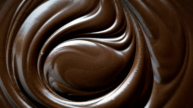 chocolate swirl background, 4k resolution - cioccolato video stock e b–roll