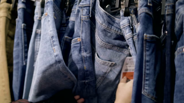 chooses jeans - jeans video stock e b–roll