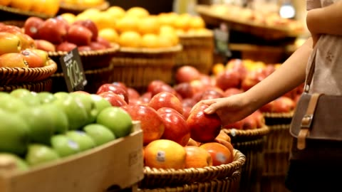 Choosing and buying apples at the store Choosing and buying apples at the store fruit stock videos & royalty-free footage