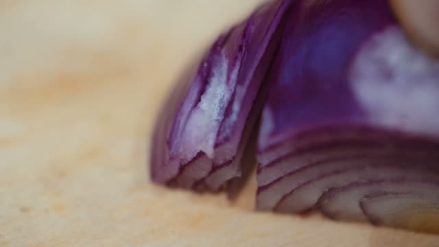 chop onion on the Board close-up. slow motion video