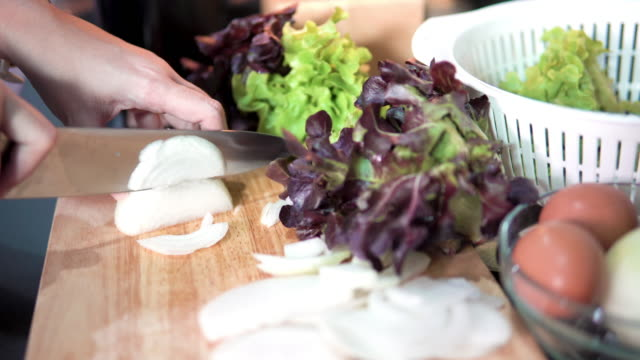 Chopping an onion on cutting board. Chopping an onion on cutting board. onion ring stock videos & royalty-free footage
