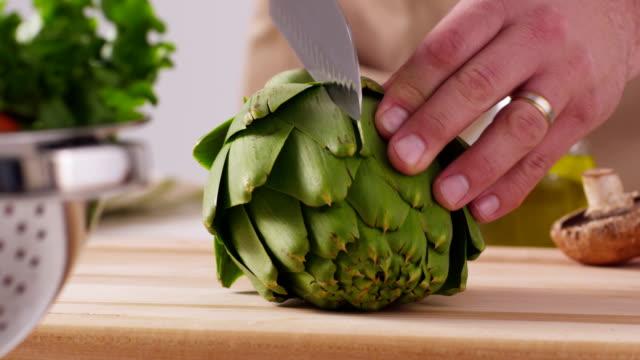 Chopping artichoke, closeup video