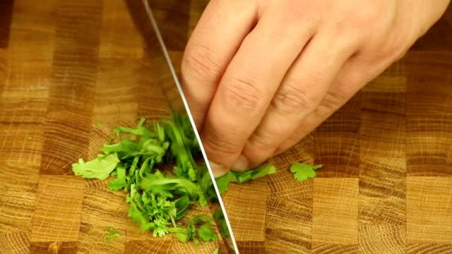 Chopping celery leaves video
