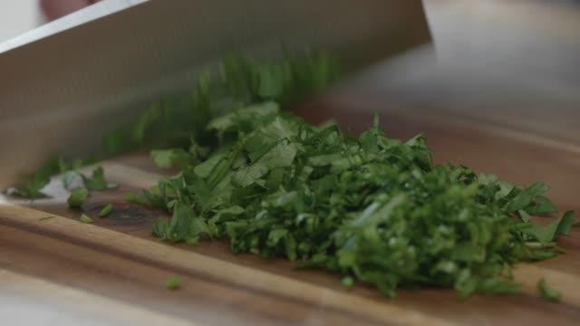 chopping coriander close up shoot chef chopping freshness coriander for garnish parsley stock videos & royalty-free footage