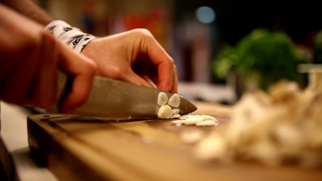 chopping garlic - chef stock videos and b-roll footage