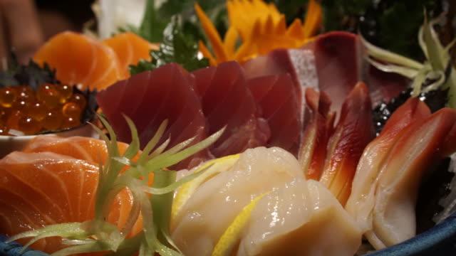 Chopsticks eating raw fresh assorted sashimi. Japanese food traditional cuisine Chopsticks eating raw fresh assorted sashimi. Japanese food traditional cuisine sashimi stock videos & royalty-free footage