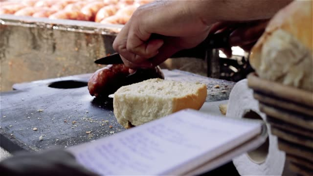 Choripan, Best Street Food In Buenos Aires (Argentina). Choripan, Best Street Food In Buenos Aires (Argentina). Close-Up. Full HD. south stock videos & royalty-free footage