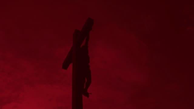 HD Christ Cross against red sky video