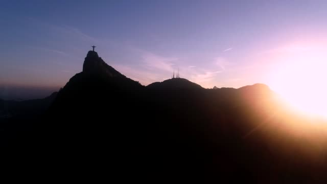 Christ the Redeemer shadow Left to right movement with a big sun at the begining. From Santa Marta Hill cristo redentor stock videos & royalty-free footage